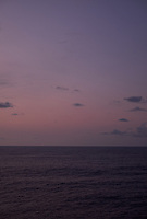 Pastel colored sky and clouds over the Pacific Ocean at dawn.  Image 20 of 21  for a panorama taken with a Fuji X-T1 camera and 35 mm f/1.4 lens  (ISO 400, 35 mm, f/2.8, 1/30 sec). Raw images processed with Capture One Pro and stitched together with AutoPano Giga Pro.