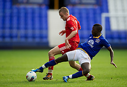 LIVERPOOL, ENGLAND - Tuesday, March 6, 2012: Liverpool's Ryan McLaughlin in action against Everton's Francisco Junior during the FA Premier Reserve League match at Goodison Park. (Pic by David Rawcliffe/Propaganda)