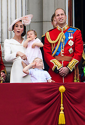 © Licensed to London News Pictures. 11/06/2016. London, UK. CATHERINE, DUCHESS OF CAMBRIDGE, PRINCESS CHARLOTTE, PRINCE GEORGE and PRINCE WILLAM on the balcony of Buckingham Palace, during the Trooping The Colour ceremony in London. This years event is part of a weekend of celebration to mark the 90th birthday of Queen Elizabeth II, who is Britain's longest reigning monarch. Photo credit: Ben Cawthra/LNP