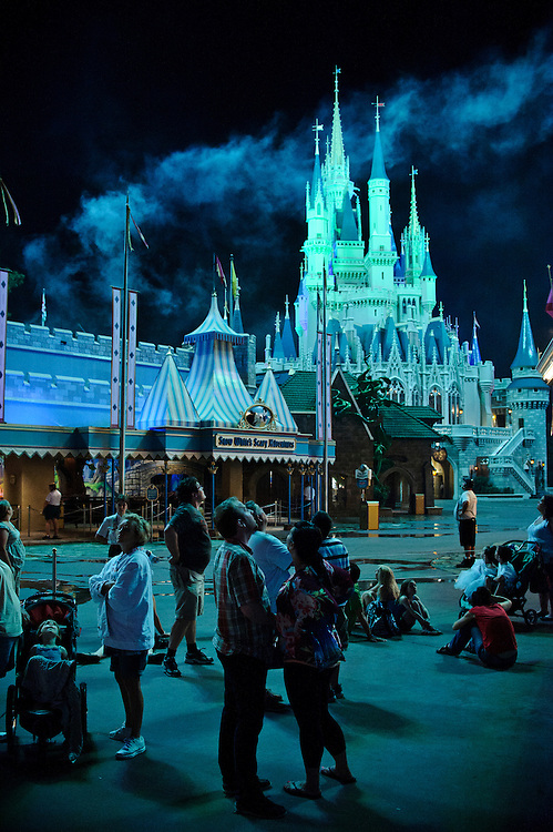 photo by Matt Roth.Tuesday, May 1, 2012..Disney World Magi Kingdom Tourists watch the daily fireworks display outside the soon to be closed Snow White's Scary Adventure ride in Orlando, Florida Tuesday, May 1, 2012. After forty-one-years, Disney World is closing the Snow White's Scary Adventure ride June 1st of this year.