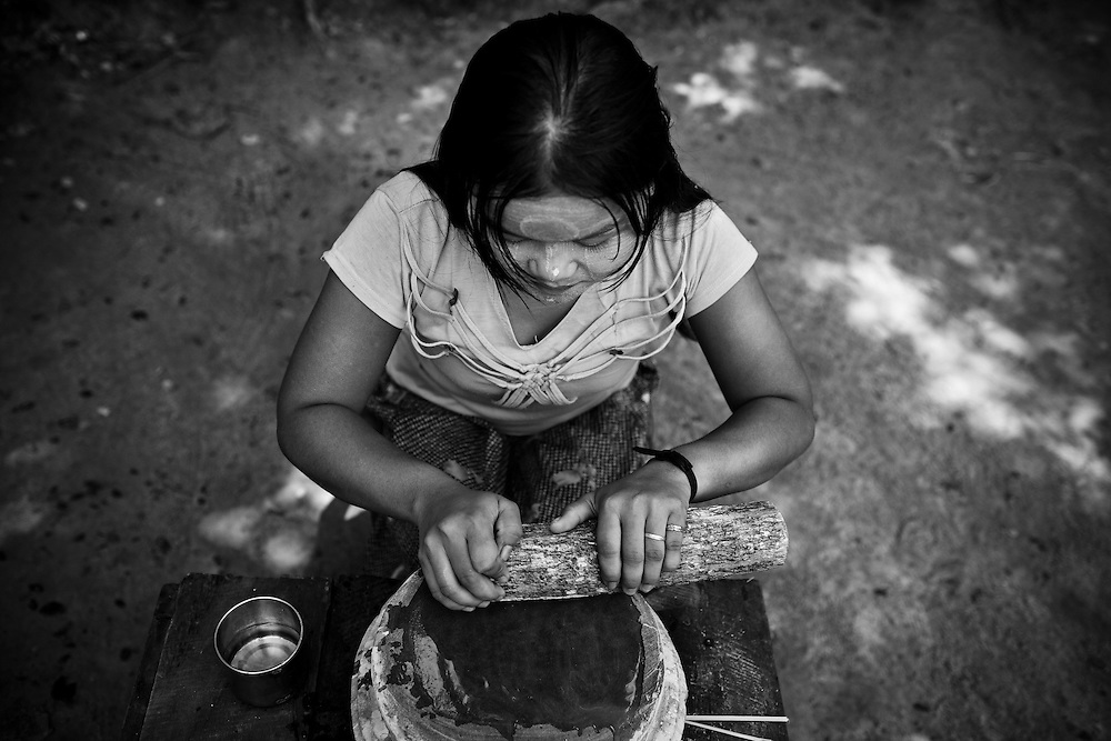 Nearly all Burmese women and children apply Thanaka to their faces daily. Made from mixing water with wood rubbed on a stone, it serves to protect their faces from the sun, as well as decoration.