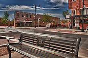 "Shot of ""standin on the corner in Winslow, Arizona"" with park bench in foreground."