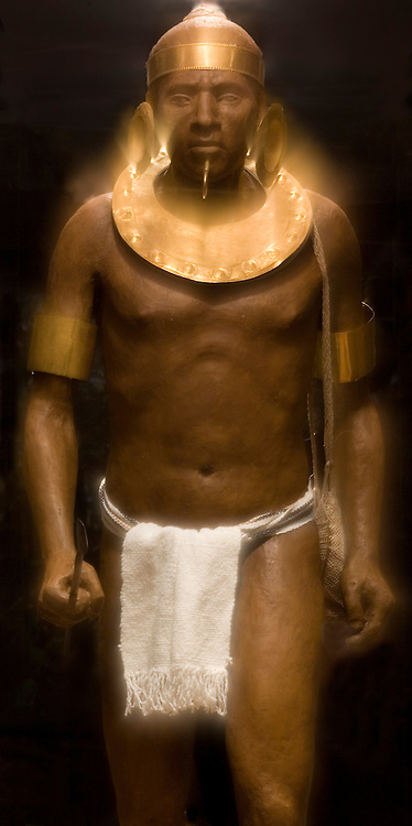 Statue of indigenous warrior with gold adronments in the Costa Rican Gold Museum, San Jose, Costa Rica.<br />