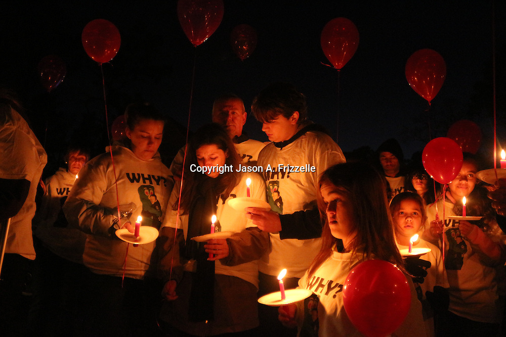 Friends and family of the late Keith Vidal joined residents of Boiling Spring Lakes and neighboring communities for a walk and vigil remembering his life. Vidal was shot and killed earlier this month by a police officer. (Jason A. Frizzelle)