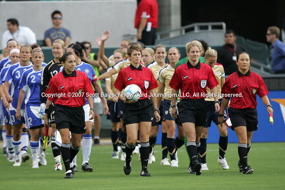 25 August 2007: Referee Kari Seitz (with ball) and Fourth Official Jennifer Bennett lead the players. The United States Women's National Team defeated the Women's National Team of Finland 4-0 at the Home Depot Center in Carson, California in an International Friendly soccer match.