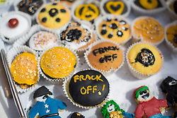 "© licensed to London News Pictures. London, UK 04/08/2013. Cakes iced with the words ""Frack off!"" made by campaigners, who protest against oil exploration in Balcombe, West Sussex on Sunday, August 04, 2013, after energy company Cuadrilla began drilling at the site two days ago. Photo credit: Tolga Akmen/LNP"