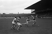 05/10/1969<br /> 10/05/1969<br /> 5 October 1969<br /> All-Ireland Junior (Home) Final: Kerry v Antrim at Croke Park, Dublin. <br /> Kerry full-forward, J. Gannan (15), loses his hurley as the ball passes him with Kerry's W. McCarthy (14) waiting for it. Antrim backs, J. Mulhalland and A. McGlane try to intercept it.