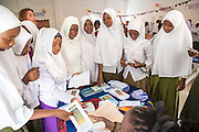 School children visiting some of the local organisation stands at the VSO ICS Community Action Day CAD held for local members of the community in Y2K Hall Lindi, Lindi region. Tanzania.