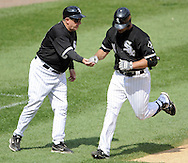 CHICAGO - JUNE 08:  Third base coach Jeff Cox #8 congratulates Paul Konerko #14 of the Chicago White Sox after Konerko hit a home run in the eighth inning against the Detroit Tigers on June 8, 2009 at U.S. Cellular Field in Chicago, Illinois.  The Tigers defeated the White Sox 5-4.  (Photo by Ron Vesely)