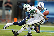 NASHVILLE, TN - SEPTEMBER 29:  Karl Klug #97 of the Tennessee Titans strips the ball loose from Geno Smith #7 of the New York Jets at LP Field on September 29, 2013 in Nashville, Tennessee.  The Titans defeated the Jets 38-13.  (Photo by Wesley Hitt/Getty Images) *** Local Caption *** Karl Klug; Geno Smith