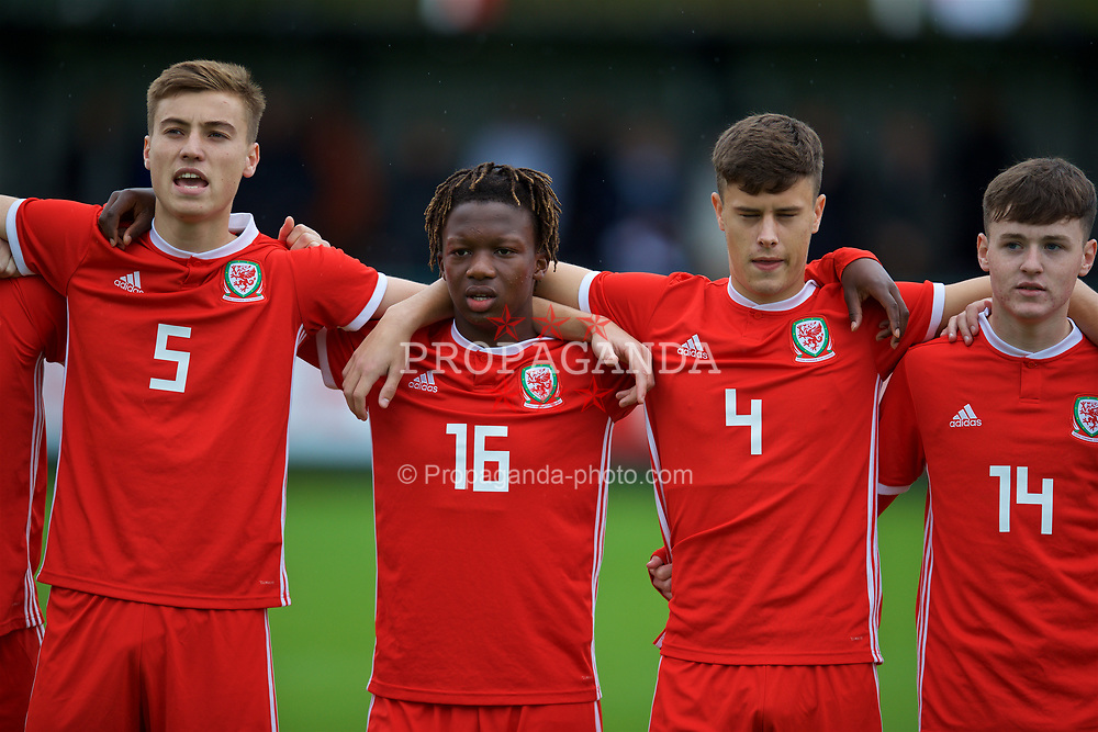 NEWPORT, WALES - Monday, October 14, 2019: Wales' (L-R) Ryan Astley, Tivonge Rushesha and Sam Bowen line-up to sing the national anthem before an Under-19's International Friendly match between Wales and Austria at Dragon Park. (Pic by David Rawcliffe/Propaganda)