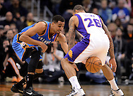 Jan. 14, 2013; Phoenix, AZ, USA; Oklahoma City Thunder guard Thabo Sefolosha (2) hits the ball loose from the hands of Phoenix Suns guard Shannon Brown (26) in the first half at US Airways Center. Mandatory Credit: Jennifer Stewart-USA TODAY Sports