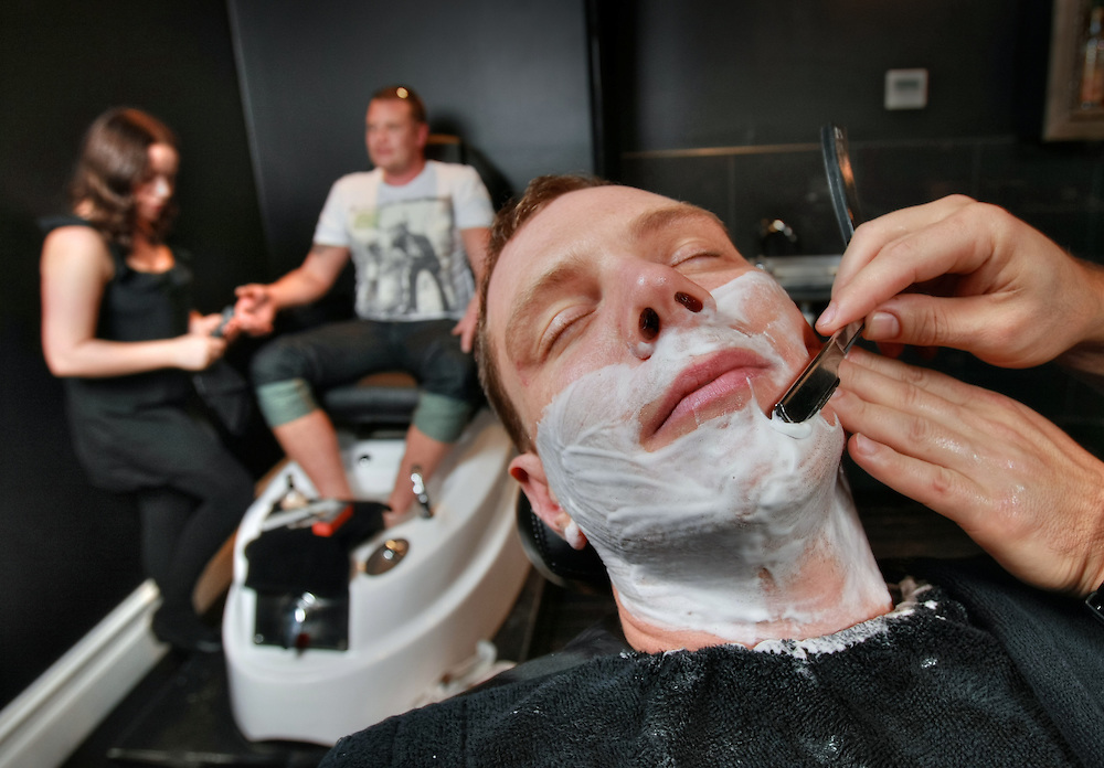 Contact Rob Gauci of Manhor - ''mens' grooming lounge'' shaves groom David Arkeveld while his brother &amp; best man Benedict Arkeveld is treated to a manicure &amp; pedicure at the hands of Gemma Zammit. Pic By Craig Sillitoe CSZ / The Sunday Age.16/06/2012  Pic By Craig Sillitoe CSZ / The Sunday Age melbourne photographers, commercial photographers, industrial photographers, corporate photographer, architectural photographers, This photograph can be used for non commercial uses with attribution. Credit: Craig Sillitoe Photography / http://www.csillitoe.com<br />