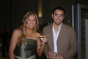 Katy Farley and Troy Farley. Cocktail party celebrating Born Free Foundation 21 years anniversary.  Royal Geographical Society, Kensington Gore. 14 march 2005. ONE TIME USE ONLY - DO NOT ARCHIVE  © Copyright Photograph by Dafydd Jones 66 Stockwell Park Rd. London SW9 0DA Tel 020 7733 0108 www.dafjones.com