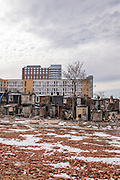 Baltimore, Maryland - March 07, 2014: Rowhomes slated to be razed sit across the street from the new Henderson-Hopkins community school. Blocks of rowhomes are being torn down to make way as part of the controversial East Baltimore Development Area project. Parts of the Johns Hopkins East Baltimore campus loom large over the neighborhood.<br /> <br /> Henderson-Hopkins is a K-8 community school in East Baltimore. The school's library, gymnasium, auditorium, Early Childhood Center, and family resource center are open to the surrounding community. The school is funded through a partnership with Baltimore City, Johns Hopkins and the Harry and Jeanette Weinberg Foundation. <br /> CREDIT: Matt Roth for The New York Times<br /> Assignment ID: 30155200A