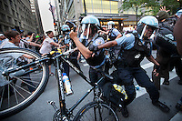 Chicago police fight back against Anti Nato protesteres as they try to break down lined up police in Chicago, IL,  May 19th 2012.