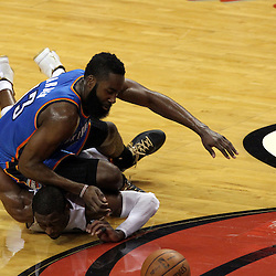 Jun 21, 2012; Miami, FL, USA; Miami Heat shooting guard Dwyane Wade (3) and Oklahoma City Thunder guard James Harden (13) go for a loose ball during the second quarter in game five in the 2012 NBA Finals at the American Airlines Arena. Mandatory Credit: Derick E. Hingle-US PRESSWIRE