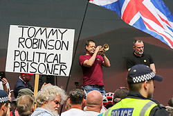 © Licensed to London News Pictures. 03/08/2019. London, UK. A bugler plays during the rally in central London. Last month Stephen Yaxley-Lennon, known as Tommy Robinson was given a nine-month prison sentence at Old Bailey after he was found guilty of contempt of court. Photo credit: Dinendra Haria/LNP