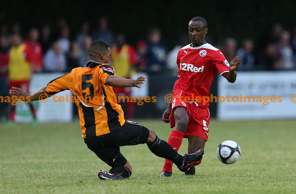 Harrold Odametey is challenged by Marlon Maxwell during the pre season friendly between Three Bridges and Crawley Town at Jubilee Field in Crawley. July 28, 2014.<br /> James Boardman TELEPHOTO IMAGES