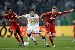 21.03.2012, Stadion im Borussia-Park, Moenchengladbach, GER, DFB Pokal, Halbfinale, VfL Borussia Moenchengladbach vs FC Bayern Muenchen, im Bild v.l. Luiz Gustavo (FC Bayern Muenchen), Havard Nordtveit (Borussia Moenchengladbach), Toni Kroos (FC Bayern Muenchen), Aktion // during the German DFB Pokal Match, Half-Final, between VfL Borussia Moenchengladbach vs FC Bayern Muenchen at the Borussia Park stadium, Moenchengladbach, Germany on 2012/03/21. EXPA Pictures © 2012, PhotoCredit: EXPA/ Eibner/ Oliver Vogler..***** ATTENTION - OUT OF GER *****