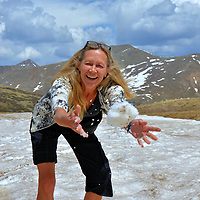 """Snowball Fight at Independence Pass, Colorado<br /> The mid-point of Colorado's most scenic drive is marked with a sign declaring: """"Independence Pass, Elevation 12,095 Feet, Continental Divide."""" Here you will understand what inspired John Denver to write, """"Rocky Mountain High."""" Also enjoy a quick snowball fight, even during the summer months. Now return to your car, turn up the heat – you will be cold - and begin your descent towards Aspen. Along the way, enjoy the splendor of White River National Forest plus Green Mountain (peaks at 6,854 feet) and Mount Shimer (elevation 12,340 feet), also called Sunshine Peak."""