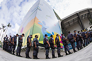 A detachment of police arrives outside the Media Centre at the Maracana stadium. A significantly increased police presence is in evidence around the Maracana stadium before the 2014 FIFA World Cup match at Maracana Stadium, Rio de Janeiro, Brazil. This follows the storming of the Stadium Media Centre by Chilean fans earlier in the week. <br /> Picture by Andrew Tobin/Focus Images Ltd +44 7710 761829<br /> 22/06/2014