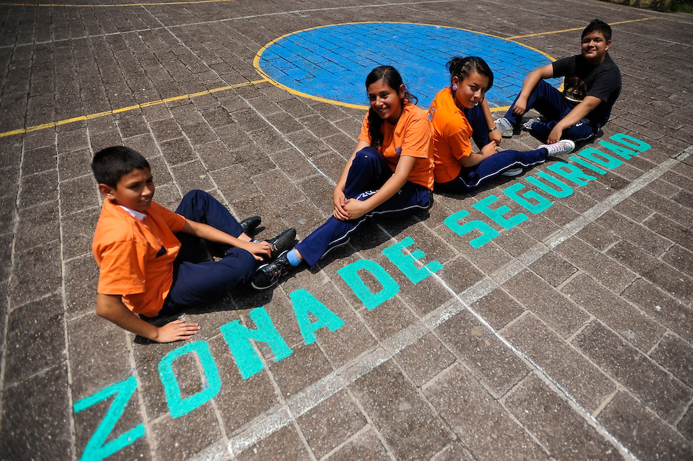 "(from Left to Right)  Rodrigo Posada, 14, Lilian Salguero,14, Astrid Vasquez, 14, and Juan Flores, 15, students who volunteer in their school's disaster brigade pose for a portrait in the school's ""security zone"" on an outside basketball court, where students are evacuated to during natual disasters. ""Above all, you have to remain calm, you cannot panic because if nerves get the best of you, you do not know what to do,"" said Salguero of being a member of the brigade.  ""People are going to be running around, not really knowing where to go, so we have to stay focused and know what to do."""