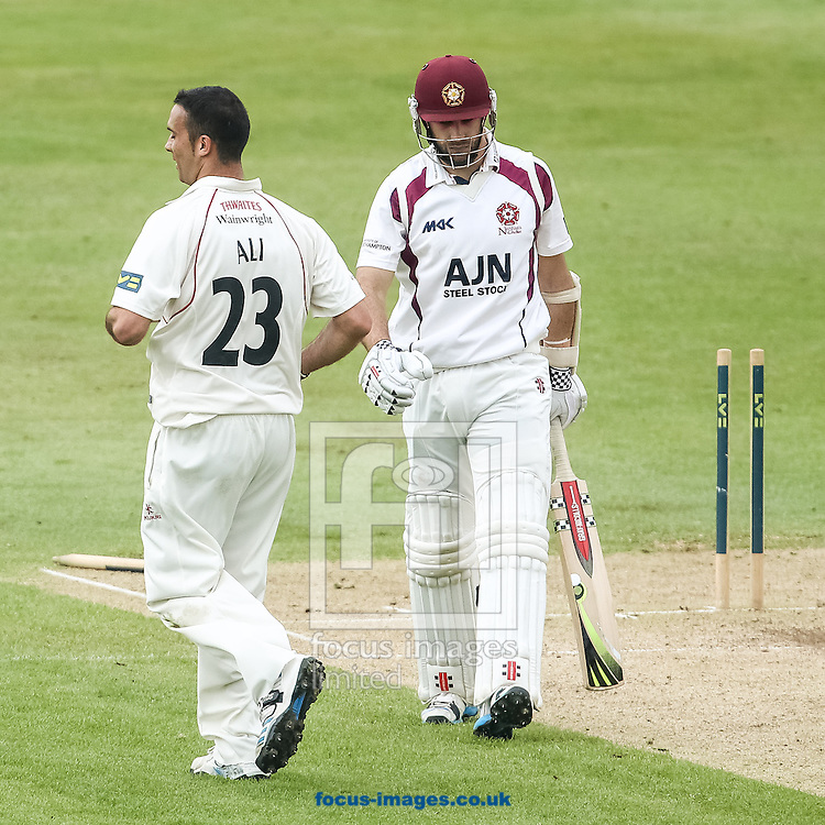 Kyle Coetzer of Northamptonshire County Cricket Club (right) is clean bowled by Kabir Ali of Lancashire County Cricket Club (left) during the LV County Championship Div One match at the County Ground, Northampton. <br /> Picture by Andy Kearns/Focus Images Ltd 0781 864 4264  29/04/2014