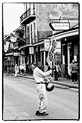 A Man wearing exaggeratedly large Mardi Gras beads advertises Huge ASS Beers.