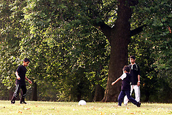 Children playing football in London's Hyde Park. Parents given permission, United Kingdom, August 25, 2000..Photo by Andrew Parsons/i-Images..