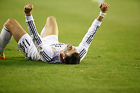 Real Madrid´s Gareth Bale celebrates his team victory after the Spanish Copa del Rey `King´s Cup´ final soccer match between Real Madrid and F.C. Barcelona at Mestalla stadium, in Valencia, Spain. April 16, 2014. (ALTERPHOTOS/Victor Blanco)