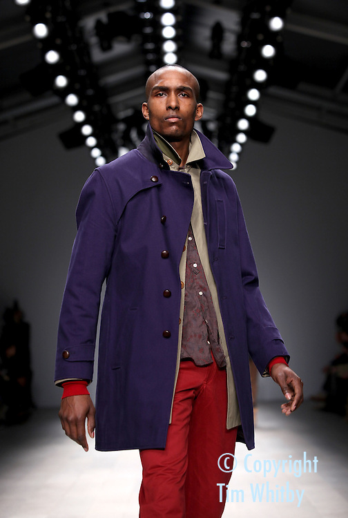 LONDON, ENGLAND - FEBRUARY 22:  A model walks the runway during the Oliver Spencer show at London Fashion Week Autumn/Winter 2012 at Somerset House on February 22, 2012 in London, England  (Photo by Tim Whitby/Getty Images)