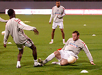 Photo: Richard Lane<br />England Training Session. 10/10/2006. <br />England's Wayne Rooney dives in to challenge Shaun Wright-Phillips.