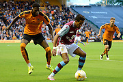 Scott Sinclair shields the ball from Dominic Iorfa during the Pre-Season Friendly match between Wolverhampton Wanderers and Aston Villa at Molineux, Wolverhampton, England on 28 July 2015. Photo by Alan Franklin.