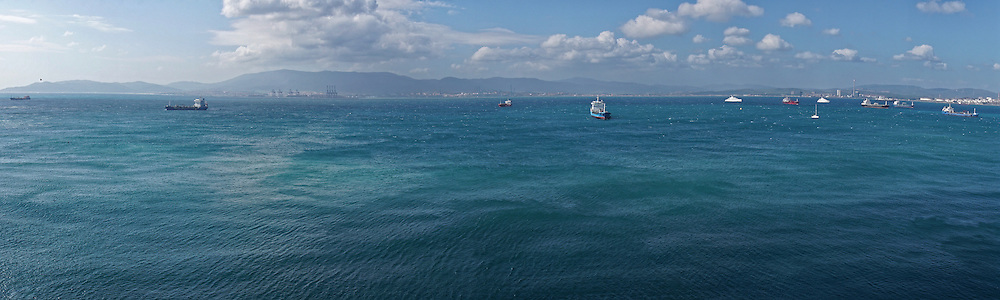 A panoramic view across the busy shipping lanes of the Bay of Gibraltar, looking from Gibraltar towards Africa.