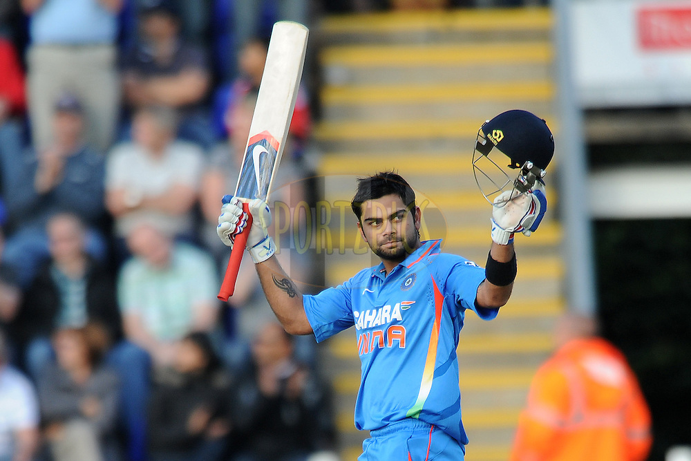 India's Virat Kholi celebrates his 107 as he leaves the field having been bowled by England's Graeme Swann during the 5th and final One Day International ( ODI ) between England and India held at Sophia Gardens in Cardiff, England on the 16th September 2011...Photo by Dan Rowley/SPORTZPICS/BCCI