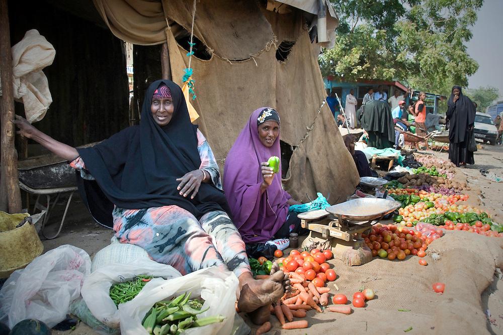 Market, Garissa, North Eastern Kenya. Two women selling vegetables (Right; Sultana Bile. Left; Halima)