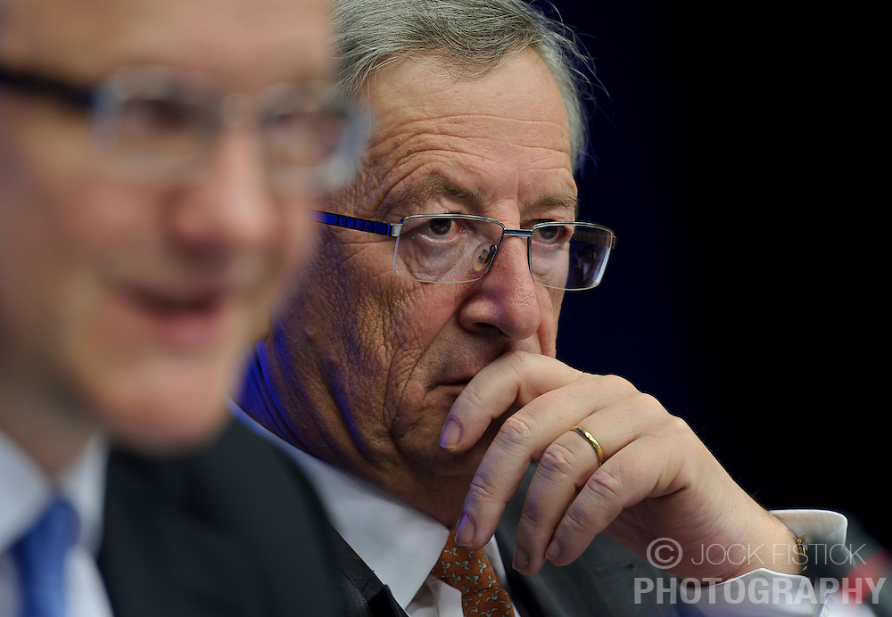 Jean-Claude Juncker, Luxembourg's prime minister, and president of the Eurogroup, right, listens during a joint press conference with Olli Rehn, The EU's economic and monetary affairs commissioner, left, following the Eurogroup meeting in Brussels, Monday Dec. 6, 2010.  (Photo © Jock Fistick).