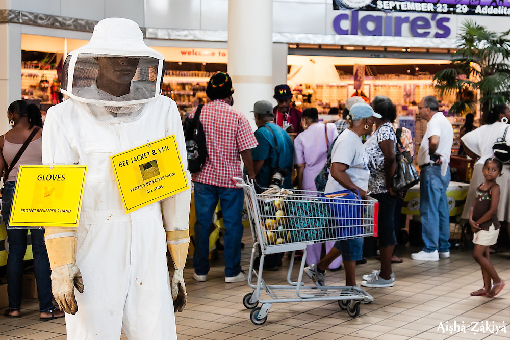 "The VI Department of Agriculture hosts the second annual Fresh Beekeeping ""Buzzaar on St. Thomas.  The event which provided education and outreach featured an observation bee hive, and byproducts of hive production including soaps, balms, wines, candles, and beekeeping supplies.  Tutu Park Mall.  22 September 2012.  © Aisha-Zakiya Boyd"