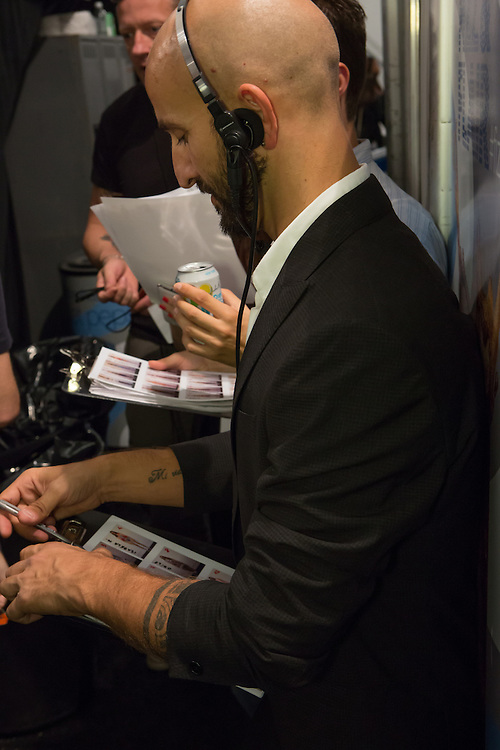 Preparing to organize models, backstage at the Custon Barcelona Spring 2013 Fashion Week show in New York.