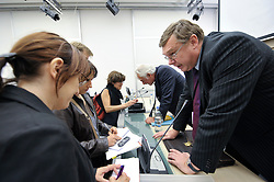 Dirk Messens, head of legal affairs for the Belgian National Lottery, left, speaks during a news conference at the International Press Center in Brussels, Belgium, Thursday, Sept. 8, 2009. The European Lotteries, an umbrella organization of the EU national lotteries, celebrated a victory in the European Union's highest court, which ruled that EU member states can prohibit commercial online gambling operations from offering games of chance via the internet to their citizens, even when these operators are based and licensed in another EU member state. (Photo © Jock Fistick)