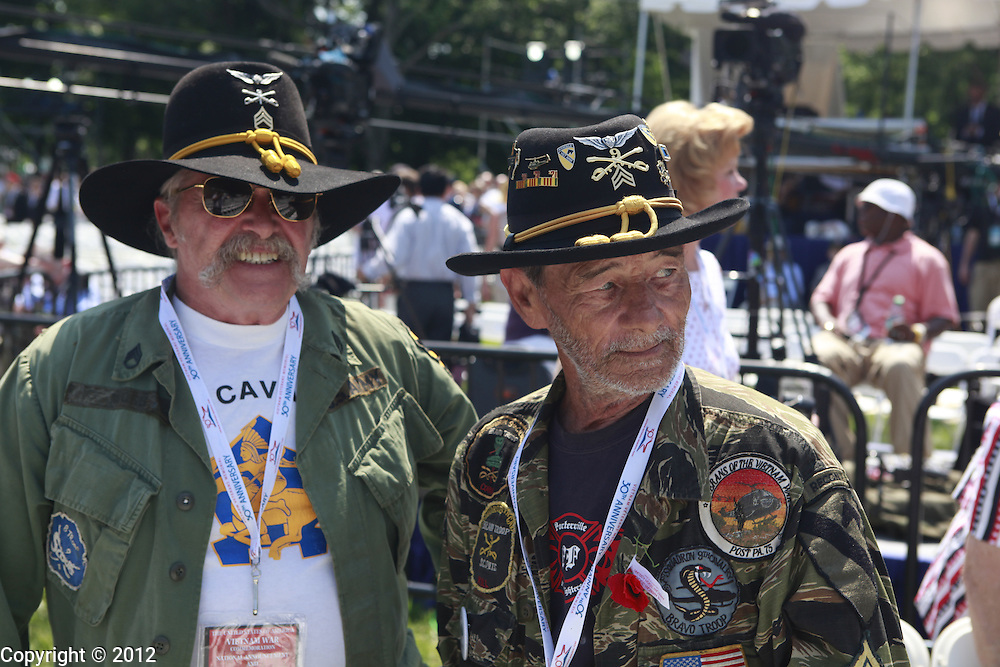 Staff sergeant (ret) Jerry Mohr, left, of Pennsylvania, and Sgt. (ret) Jerry Hogan, both of whom served in Bravo Troop, 1st Squadron, 9th Cavalry, 1st Cavalry Division from 1969-1970 meet for the first time since the war, before the States of America Vietnam War Commemoration National Announcement and Proclamation Ceremony at the Vietnam Veterans Memorial Wall.