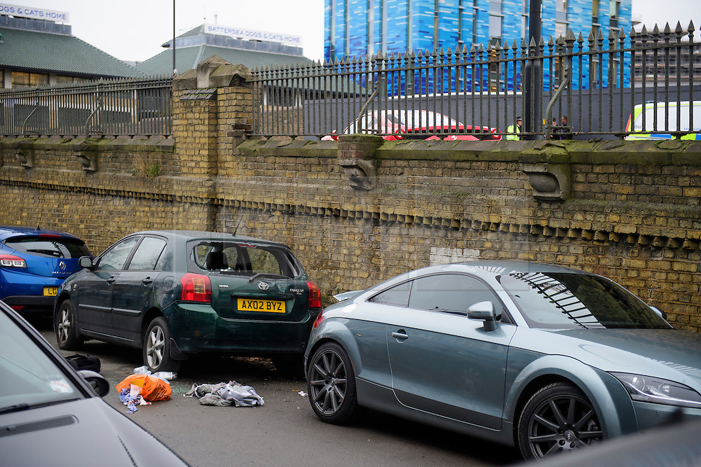 © Licensed to London News Pictures. 12/12/2016. London, UK. A smashed rear window of a car and bloodied clothing on the ground where a person was thrown over the railing of a bridge when a Ferrari sports car ploughed in to a group of pedestrians in Battersea, South London. Photo credit: Ben Cawthra/LNP