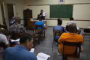 A group of immigrants in a Portuguese lesson at Missao Paz.<br /> <br /> The Mission provides advice and support on employment, health, family, community and education. They also have residential quarters where people can stay when they have no where else. <br /> <br /> Their mission is to welcome, understand, integrate and celebrate the lives of immigrants and refugees, dreaming of a universal citizenship.