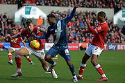 Birmingham City midfielder Jacques Maghoma attacks watched by Bristol City defender Aden Flint and Bristol City defender Mark Little during the Sky Bet Championship match between Bristol City and Birmingham City at Ashton Gate, Bristol, England on 30 January 2016. Photo by Alan Franklin.