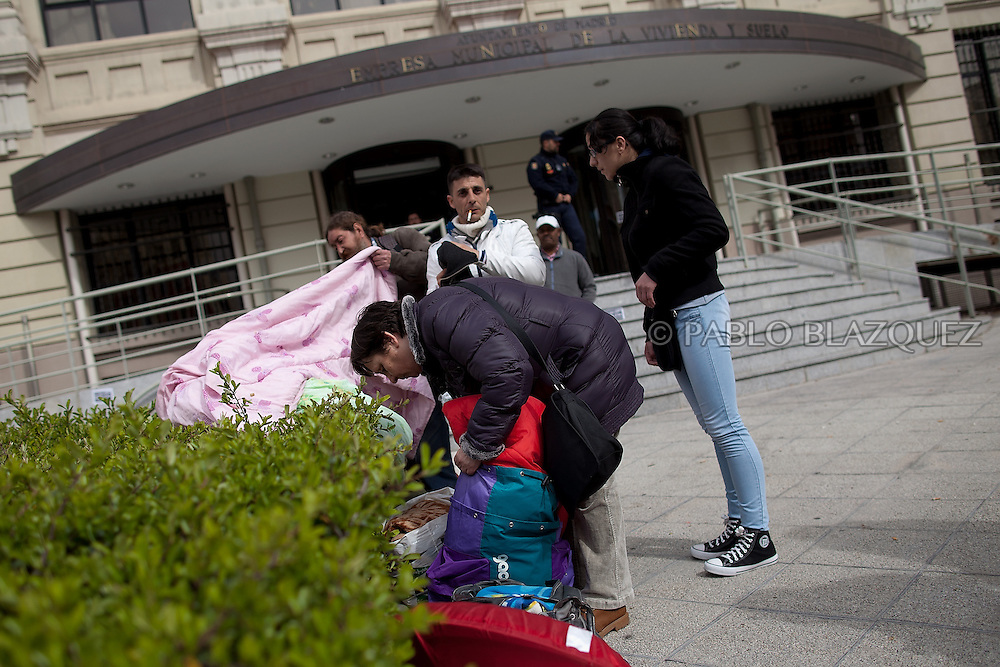 Amalia Torres 51, (C) pack up her belongings one day before her eviction takes place outside the Madrid's Council Housing Office where she spent the night claiming to stop her eviction on April 3, 2013 in Madrid, Spain. The Mortgage Holders Platform (PAH) and other anti evictions organizations are organizing 'escraches' since several weeks ago outside Popular Party deputies houses and offices to demand the vote for a Popular Legistative Initiative (ILP) to stop evictions, regulate dation in payment and social rent.