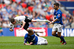 Peterborough Midfielder Danny Swanson (SCO) is brought down by Chesterfield Defender Ritchie Humphreys (ENG) - Photo mandatory by-line: Rogan Thomson/JMP - 07966 386802 - 30/03/2014 - SPORT - FOOTBALL - Wembley Stadium, London - Chesterfield FC v Peterborough United - Johnstone's Paint Trophy Final.