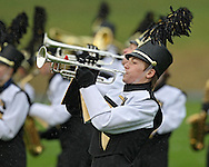 Jordan Denison, 17, plays along with the Stormin' Pointer Marching Band from Center Point-Urbana High School during the 33rd Annual Marion Marching Invitational at Thomas Park Field in Marion on Saturday, September 28, 2013.