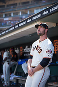 San Francisco Giants relief pitcher Josh Osich (61) hangs out in the dugout during a MLB game against the Arizona Diamondbacks at AT&T Park in San Francisco, California, on August 6, 2017. (Stan Olszewski/Special to S.F. Examiner)