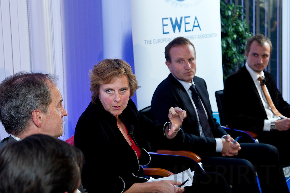 From left: Jo Leinen MEP, Chairman of the Environment, Public Health and Food Safety Committee, European Parliament, Connie Hedegaard, European Commissioner for Climate Action, Martin Lidegaard, Minister for Climate, Energy and Building, Denmark, and  Josche Muth, Acting Secretary General, EREC - European Renewable Energy Council, at the EWEA Debate meeting on Achieving 30% lower emissions in the EU: the role of wind energy & other renewables at the EWEA office in Brussels 8 November 2011. Photo: Erik Luntang/INSPIRIT